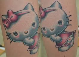 small hello kitty tattoo by morepunkthanyou