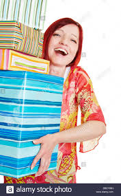 what to get an elderly woman for christmas happy elderly woman carrying many christmas gifts stock photo