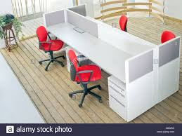 office desks and red chairs cubicle set view from top over wood