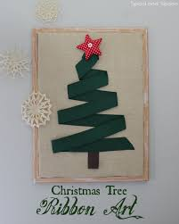 huge christmas tree wall art made out of a large cork board and