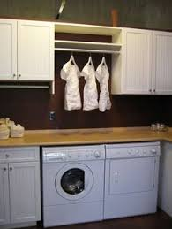 Laundry Room Cabinets With Hanging Rod Creating The Laundry Room California Closets Dfw