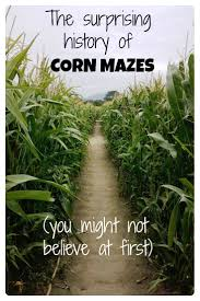 the history of corn mazes points with a crew