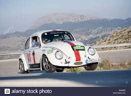 volkswagen car white white 1965 volkswagen beetle classic car racing in the classic car