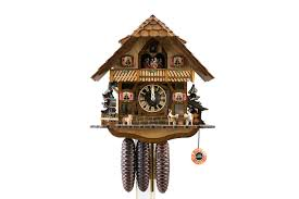 black forest house cuckoo clock with visible clockwork