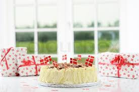 typical birthday cake with presents stock photo colourbox