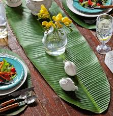 table setting runner and placemats turn your table into a tropical paradise with green palm leaves
