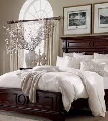 traditional master bedroom with arched window by eileen winfrey