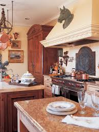 kitchen big rustic island and pot rack in mediterranean kitchen