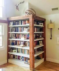 Bookshelves Corner by A Square Rotating Bookcase Without Plans But I Like The Bars