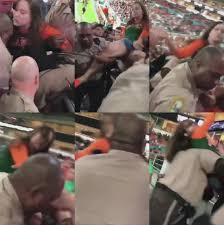 miami fan slaps officer viral video of miami dade officer punching woman at um game
