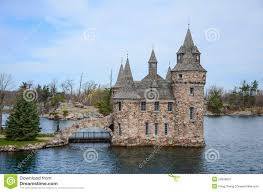 one small island and castle on st lawrence river stock photo