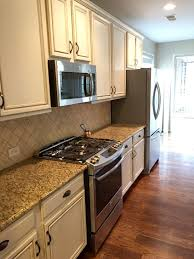 Refurbishing Kitchen Cabinets Painting Kitchen Cabinets Before After Mr Painter Paints