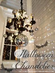 How To Decorate A Chandelier Our Victorian Front Porch Decorated For Halloween Diy Chandelier