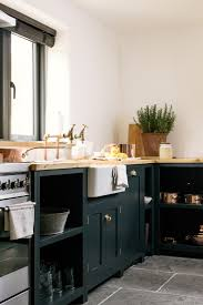 reclaimed brass taps a big farmhouse sink simple devol kitchen