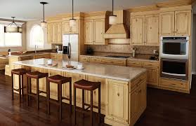 limestone countertops rustic alder kitchen cabinets lighting