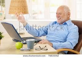 Laughing Man Meme - laughing old man using laptop computer stock photo 75633352