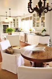 kitchen amusing antique wooden round dining table with single amusing antique wooden round dining table with single white fabric armchair and modern kitchen cabinetry white themes panels and pendant lamps also corner