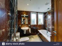 Spanish Bathroom Design by Glass Shower Screen On Bath In Modern Spanish Bathroom With Voile