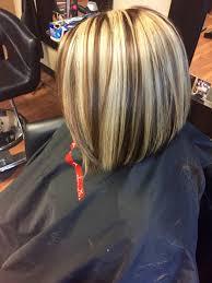 chunky short haircuts chunky blonde highlight with a mocha brown base and short hair bob