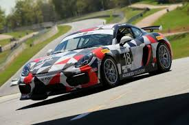 porsche cayman racing racing newcomer swearingin aims for more podiums in porsche cayman