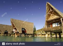 the overwater bungalows of the kuenda beach resort in noumea in