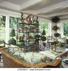 solarium sunroom picture of solarium sunroom with topiary bakers rack wicker