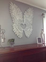 angel wings made out of cardboard painted white and dry brushed