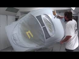 volkswagen beetle gets painted inside the paint booth time