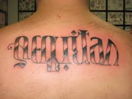 aequitas veritas ambigram tattoo on upperback