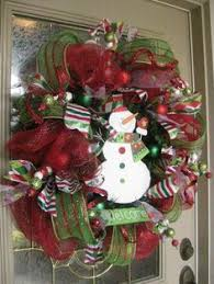 battery operated lighted christmas bows decorating wooden front doors home depot decorated christmas wreaths