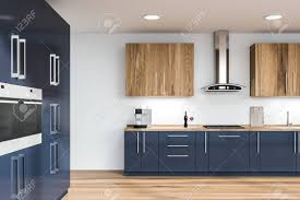 blue kitchen cabinets with wood countertops interior of modern kitchen with white walls wooden floor blue