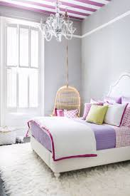 bedroom gray bedroom with white bed having white blanket and