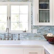 brown glass mosaic backsplash kitchen with wooden cabinets and