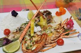 cuisine langouste plancha duo de la mer langouste et poisson exotique mariné dans une sauce