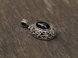 silver pendant necklace handmade images Ethnic silver pendant of oval shape with onyx in a floral frame jpg