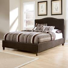 kasidon king upholstered bed with brown woven fabric arched