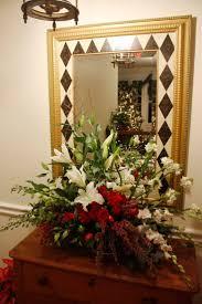 50 best christmas ideas images on pinterest flower arrangements christmas flower arrangements holiday flower arrangement matching the fresh flower christmas tree