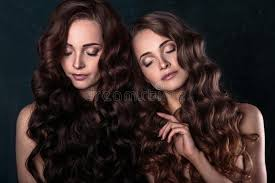 hair styles for a young looking 63 year old woman beautiful twins young women with natural make up and hair style