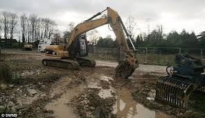 housing giant bulldozes 24 brand new homes after building on land