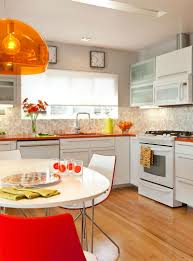 24 mid century modern interior decor ideas brit co color splash tiled backsplash bright open space and can we talk about the citrus orange hue the countertops and suspension light really brighten things