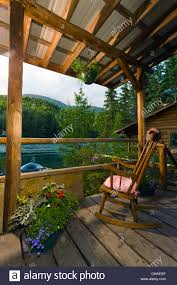 rustic cabin porch with chair at alaska river u0027s company in cooper