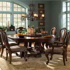 rustic dining room with round wooden dining room table wrought