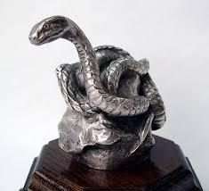 1910 coiled snake car mascot ornament