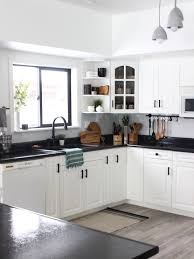 black and white kitchen cabinets white kitchen cabinets with black countertops are the next