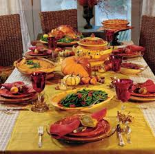 setting up a table for thanksgiving dinner autumn home decor on