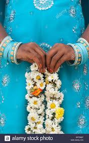 indian holding flowers stock photos u0026 indian holding