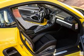 porsche black interior first drive porsche 718 cayman racing yellow in south of france
