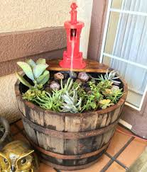 Half Barrel Planters by Wine Barrel And Old Fashion Water Hand Pump Fountain Every Yard