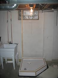 Installing Basement Shower Drain by Basement Bathroom Installation
