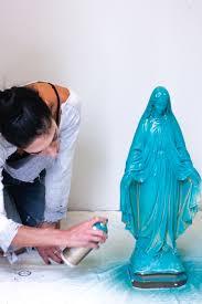 spray painting virgin mary statue eyeswoon